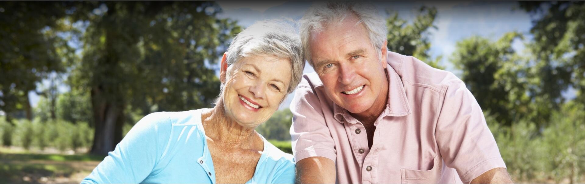 Happy senior couple after having dental implant treatment
