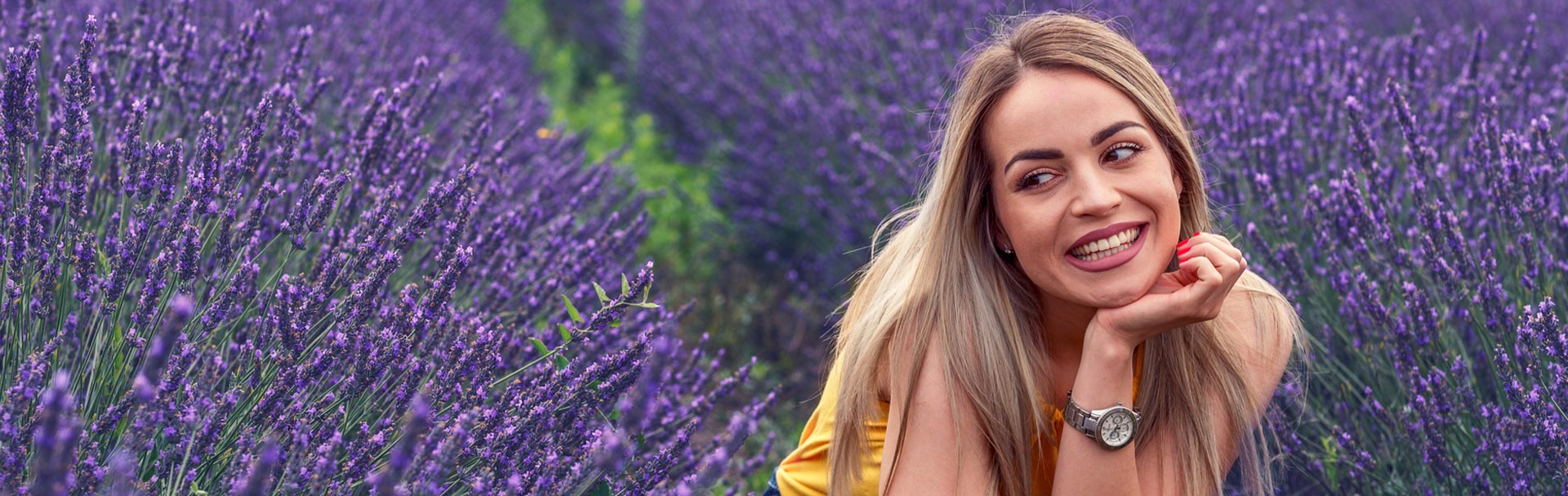 Beautiful young woman on the lavender field