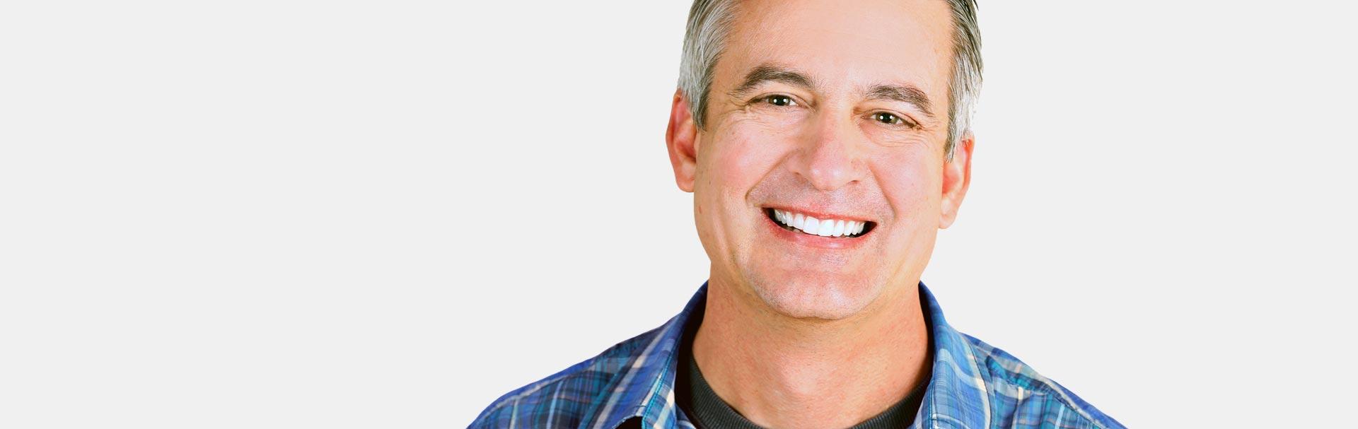 Smiling man after having safe amalgam removal treatment