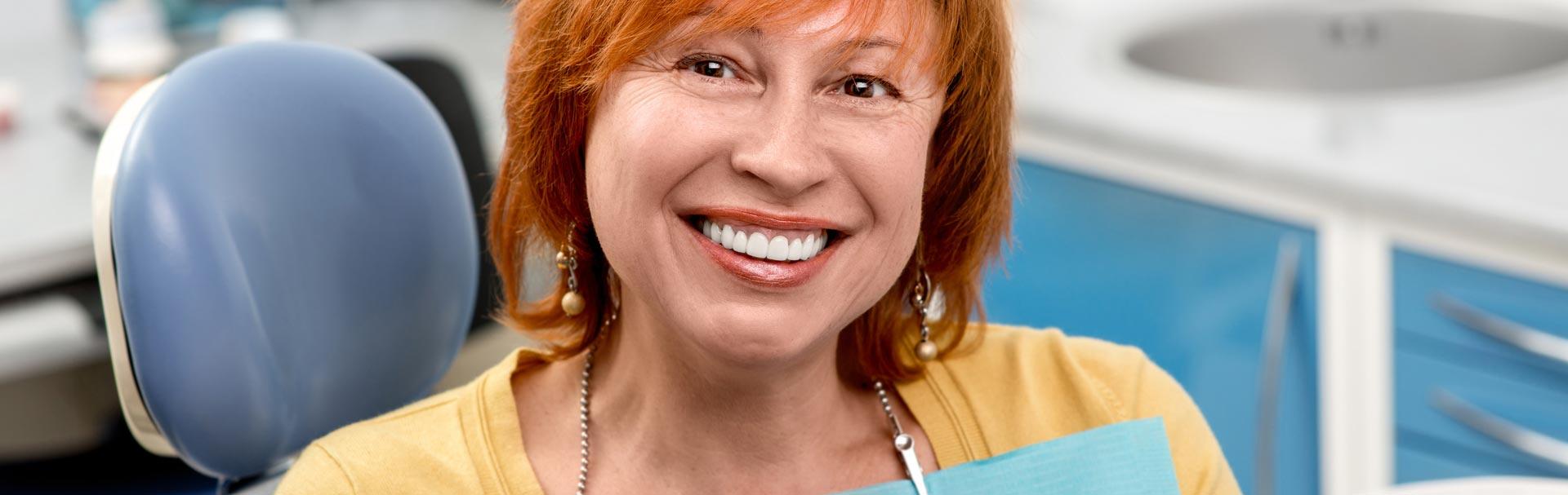 Happy elderly woman having dentures