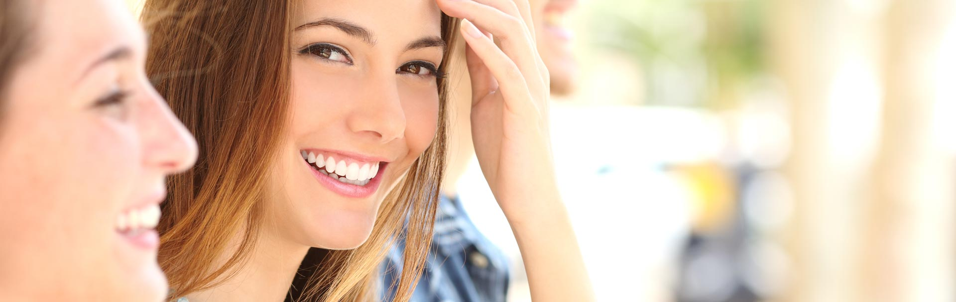 Happy woman after having dental veneers treatment